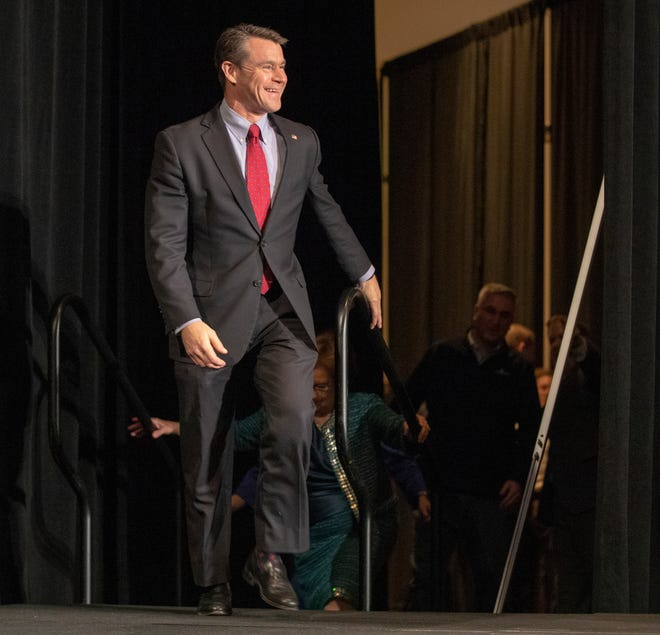 Todd Young, U.S. Senator, takes the stage with a group of dignitaries before Mike Braun gives his acceptance speech GOP election night event at the JW Marriott, Indianapolis, Tuesday, Nov. 6, 2018.