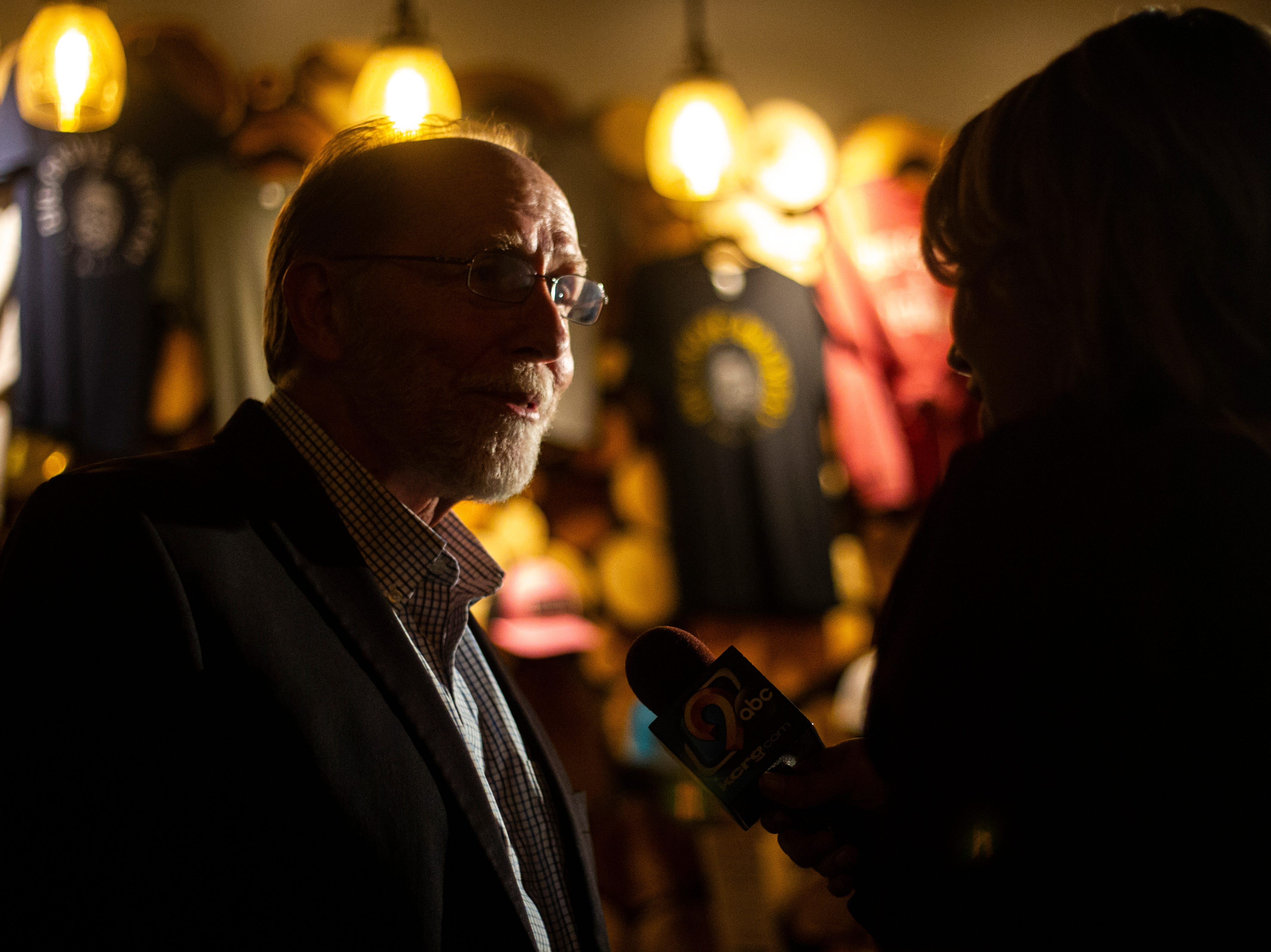U.S. Rep. Dave Loebsack, D-Iowa, speaks with a reporter during the Johnson County Democrats watch party on Tuesday, Nov. 6, 2018, at Big Grove Brewery in Iowa City.