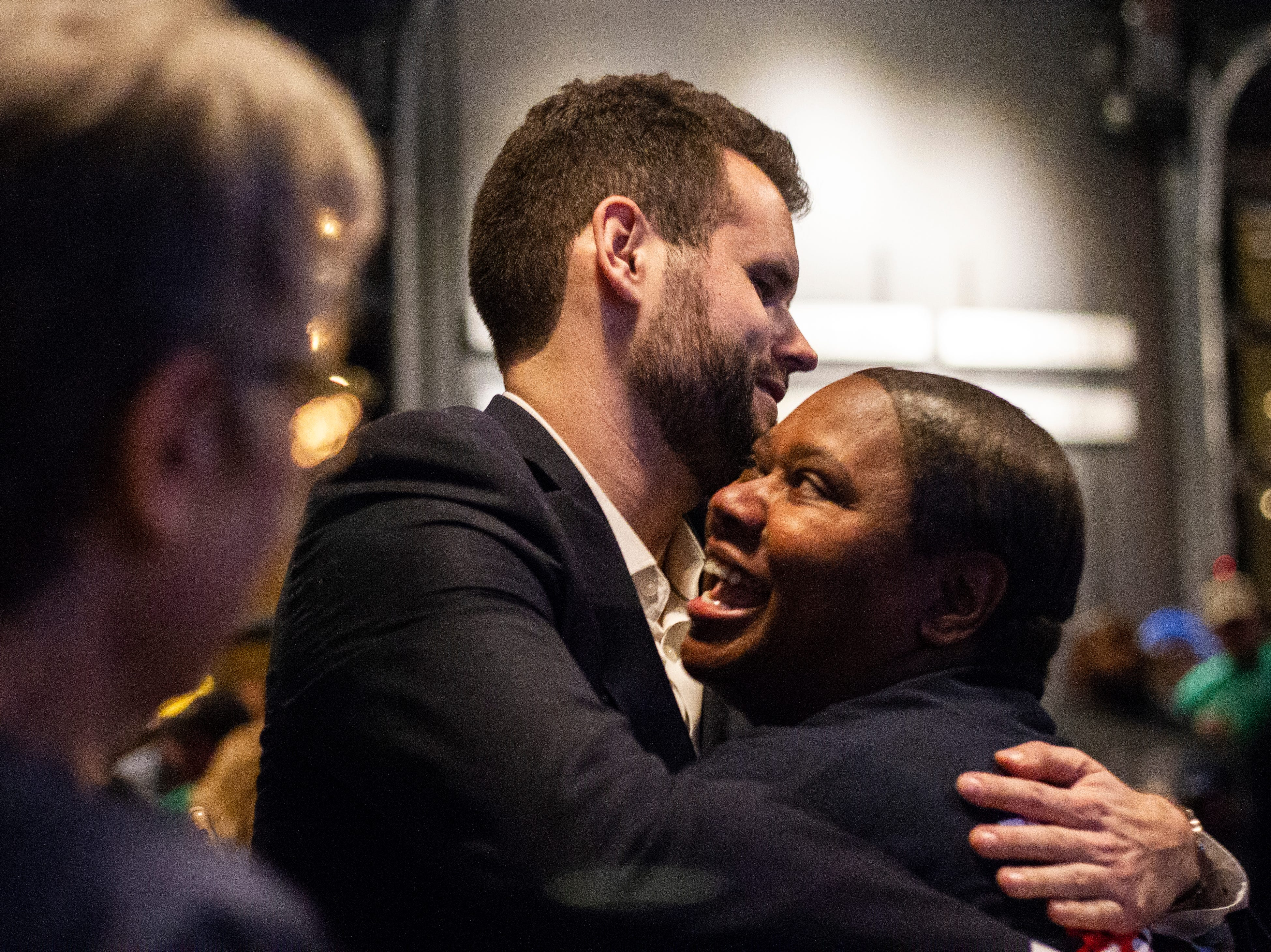 Zach Wahls embraces Royceann Porter during the Johnson County Democrats watch party on Tuesday, Nov. 6, 2018, at Big Grove Brewery in Iowa City.