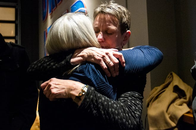 Pat Heiden embraces a supporter during the Johnson County Democrats watch party on Tuesday, Nov. 6, 2018, at Big Grove Brewery in Iowa City.