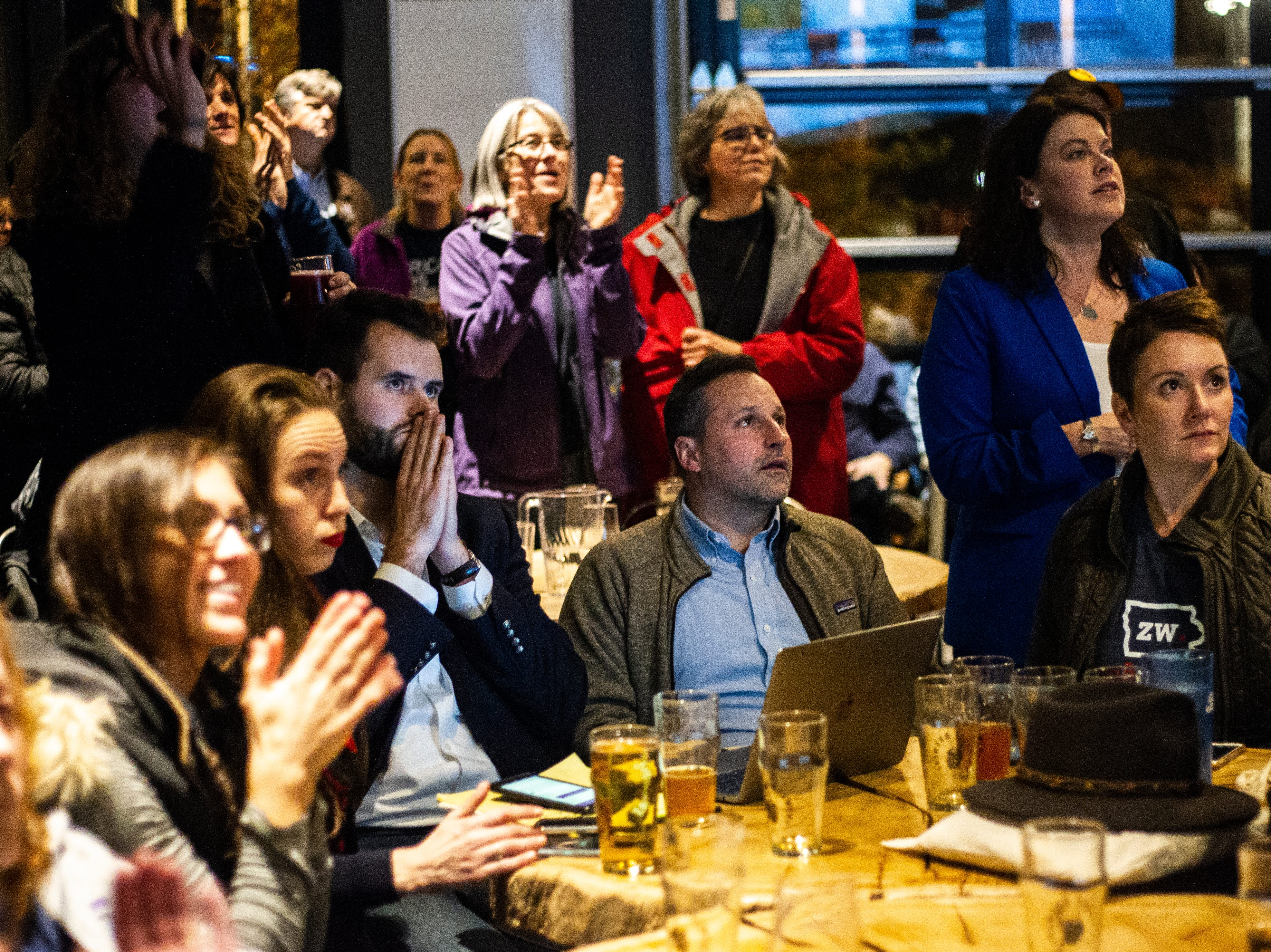 Zach Wahls watches results come in during the Johnson County Democrats watch party on Tuesday, Nov. 6, 2018, at Big Grove Brewery in Iowa City.