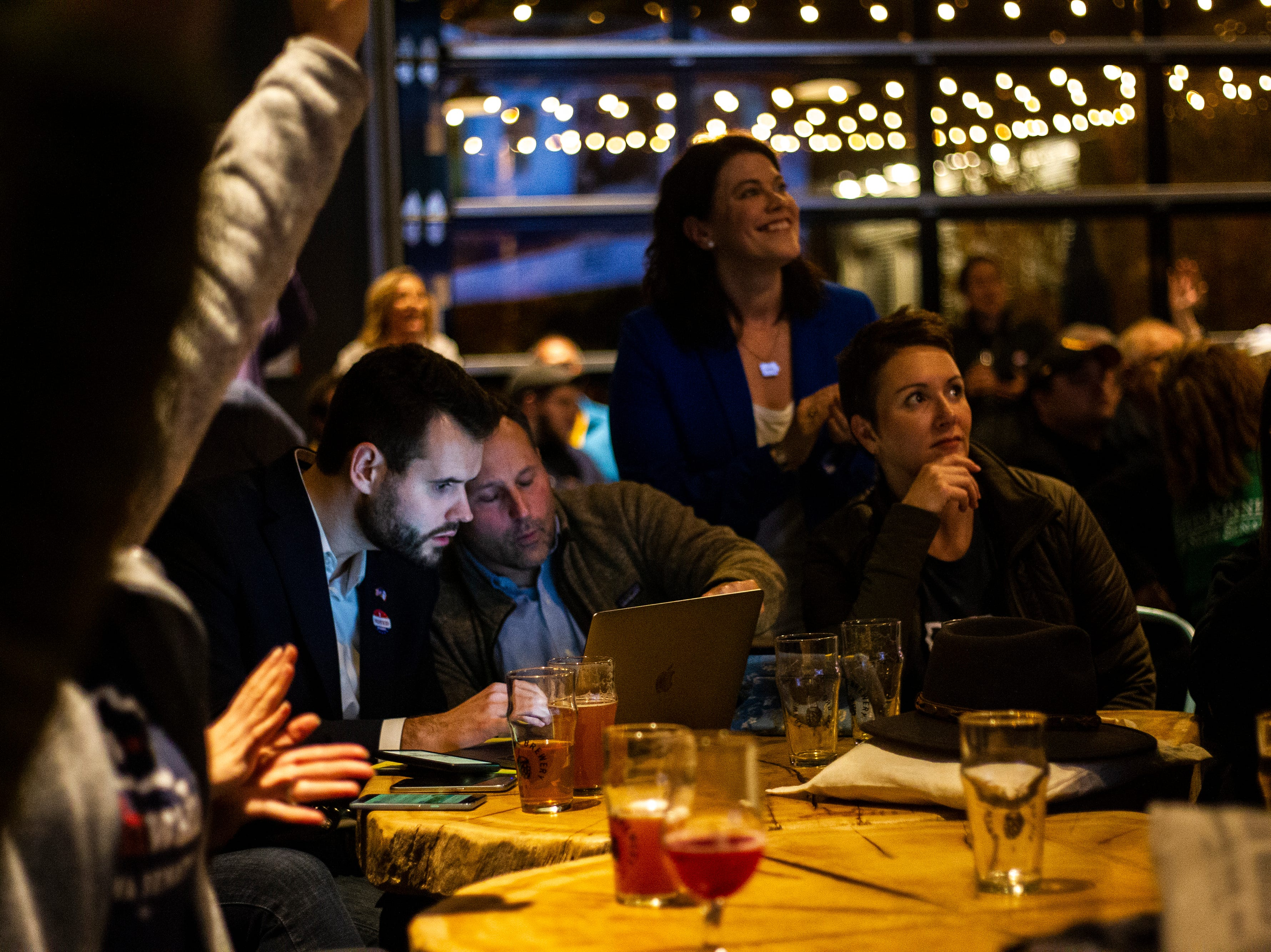 Zach Wahls checks results on his computer during the Johnson County Democrats watch party on Tuesday, Nov. 6, 2018, at Big Grove Brewery in Iowa City.