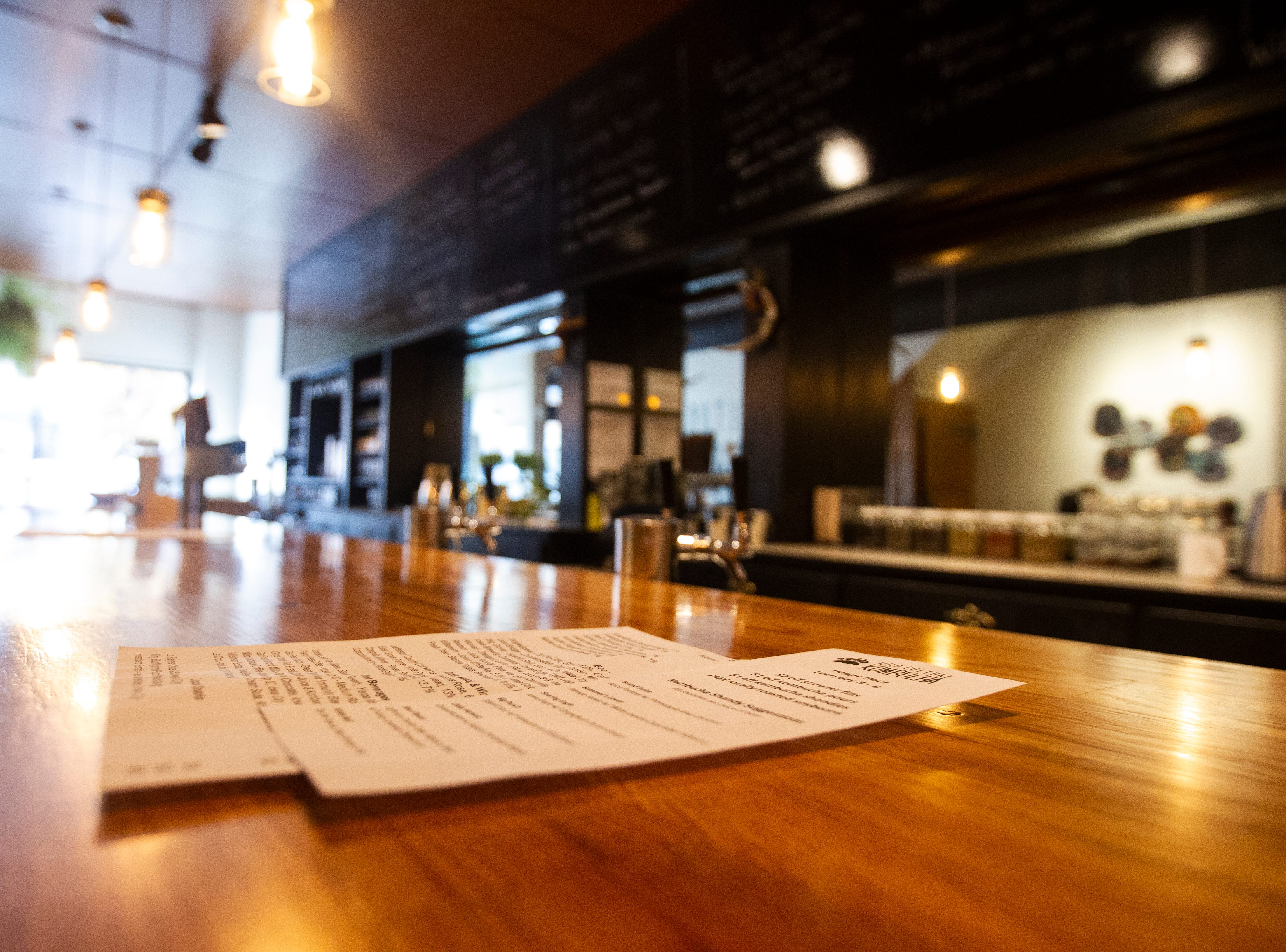Menus rests on the bar on Wednesday, Oct. 31, 2018, inside Wild Culture Kombucha in Iowa City.