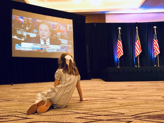 Caroline McPhillips, 8, watches election results come in at the Westin in Jackson. McPhillips is the grandchild of Sen. Roger Wicker, who run re-election Tuesday night against Democrat David Baria of Bay St. Louis.
