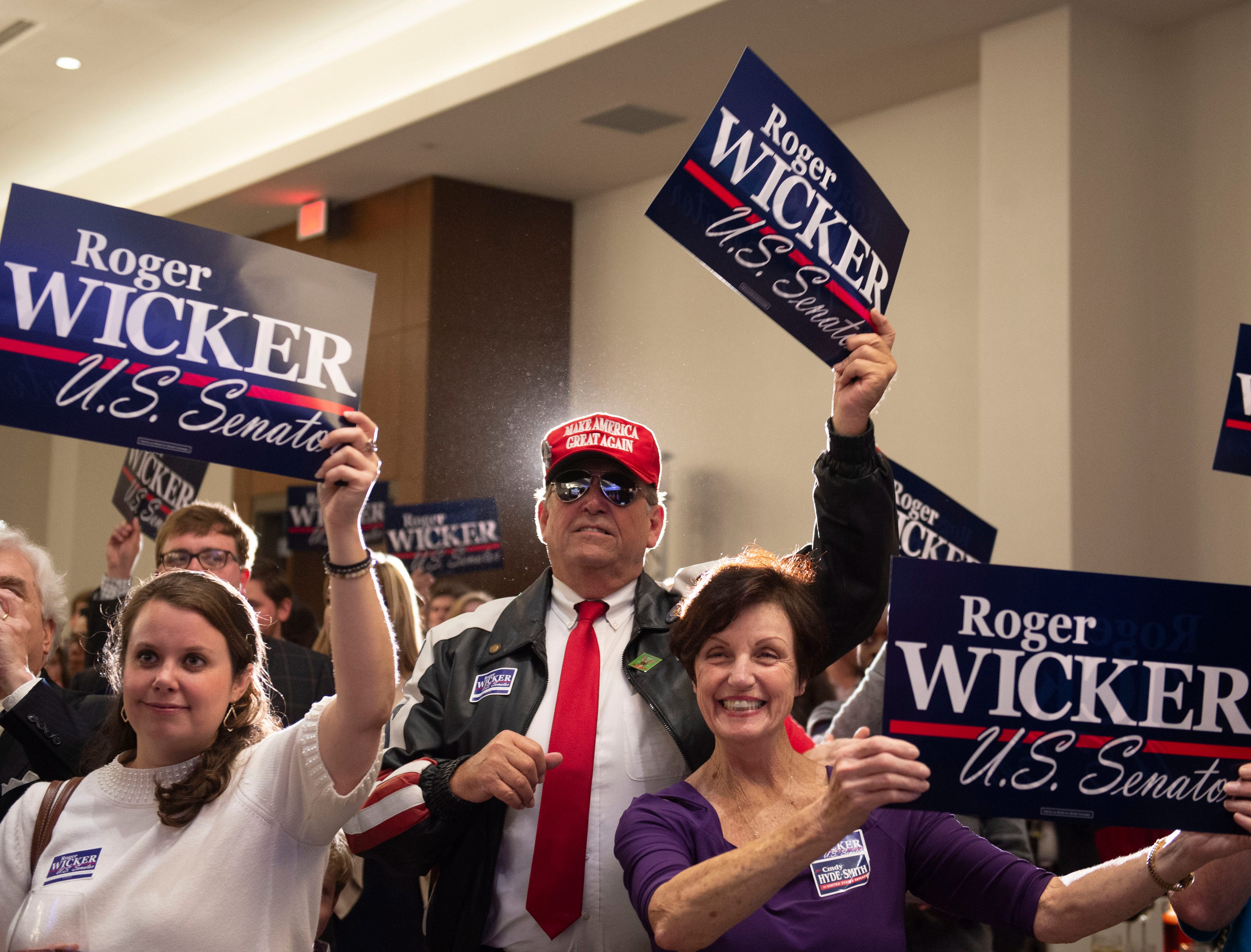 Supporters of U.S. Senator Roger Wicker celebrates his arrival to the ballroom of the Westin hotel in downtown Jackson as Wicker makes his way to the stage to give his acceptance speech. Tuesday, Nov. 6, 2018.