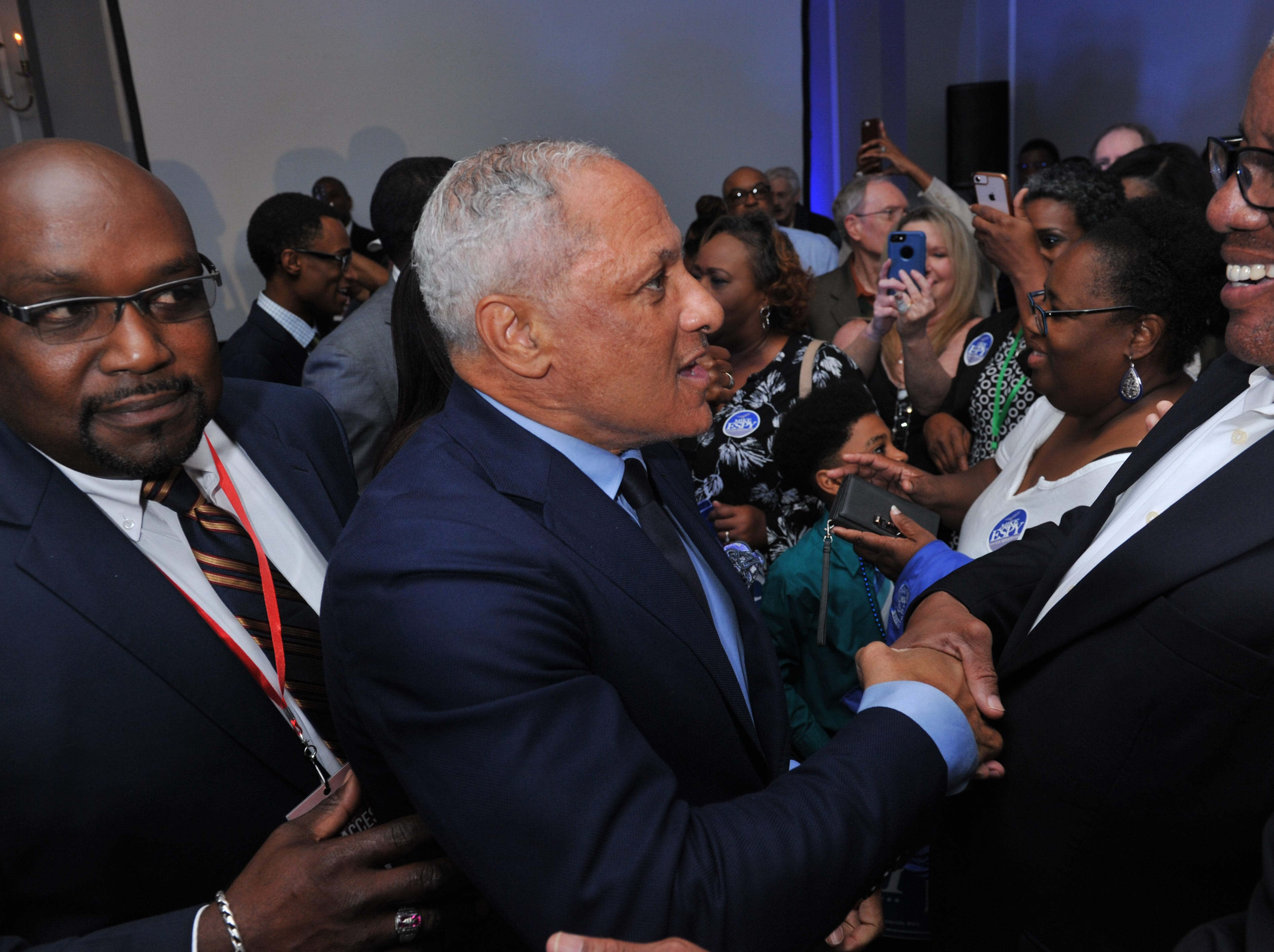 Democratic Senate candidate Mike Espy, center, makes his way through the crowd after announcing to an awaiting crowd at his election night party at the Jackson Hilton on Tuesday, Nov. 6, 2018, that a runoff against Republican opponent Cindy Hyde-Smith is in the future. The runoff is set for Nov. 27, 2019.