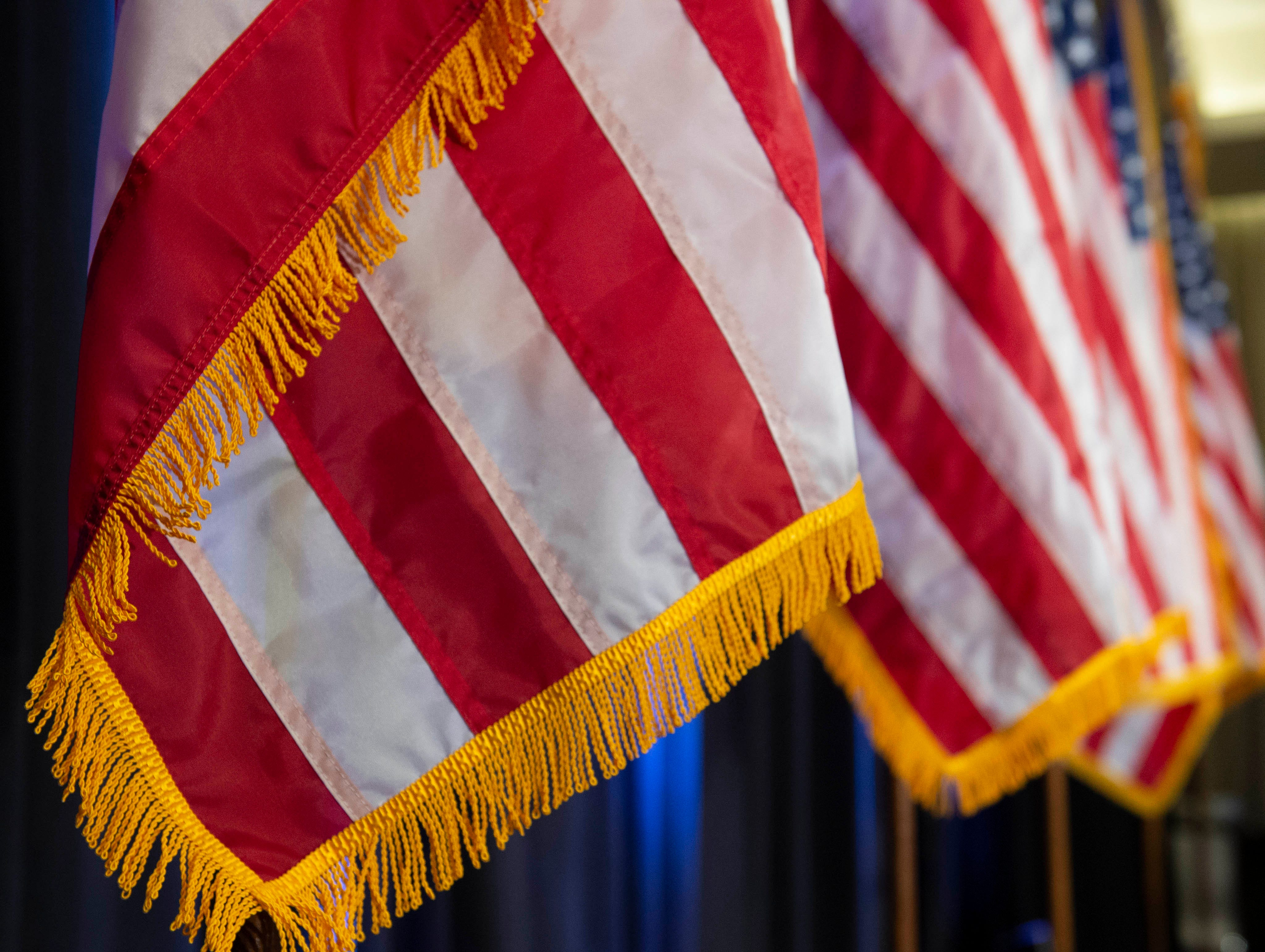 American flags stand along the stage in the ballroom of the Westin hotel during the election night party for Sen. Cindy Hyde-Smith. Jackson, Miss. Tuesday, Nov. 6, 2018.