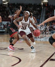 Mississippi State's Jazzmun Holmes (10) drives to the basket in the first half. Mississippi State opened the 2018-19 season against SE Missouri State on Tuesday, November 6, 2018. Photo by Keith Warren
