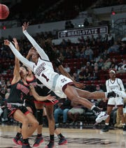 Mississippi State's Myah Taylor (1) is tripped as she drives to the basket in the second half. Mississippi State opened the 2018-19 season against SE Missouri State on Tuesday, November 6, 2018. Photo by Keith Warren