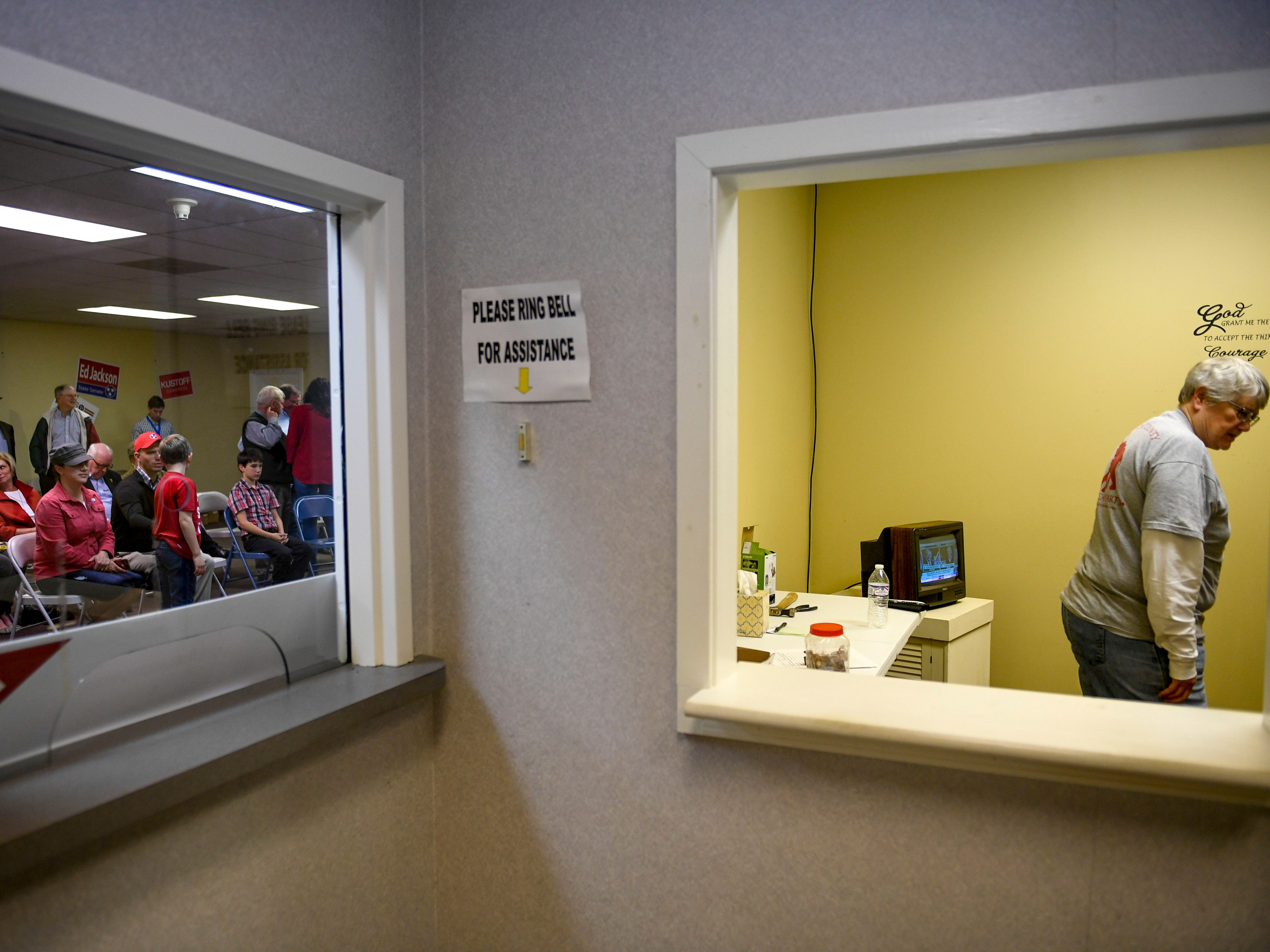 Donna Webb, who helps run the Madison County Republican Party, watches national election coverage in a small room to the side while the rest of participants watch in the main room during an election night watch party at Madison County Republican Headquarters in Jackson, Tenn., on Tuesday, Nov. 6, 2018.