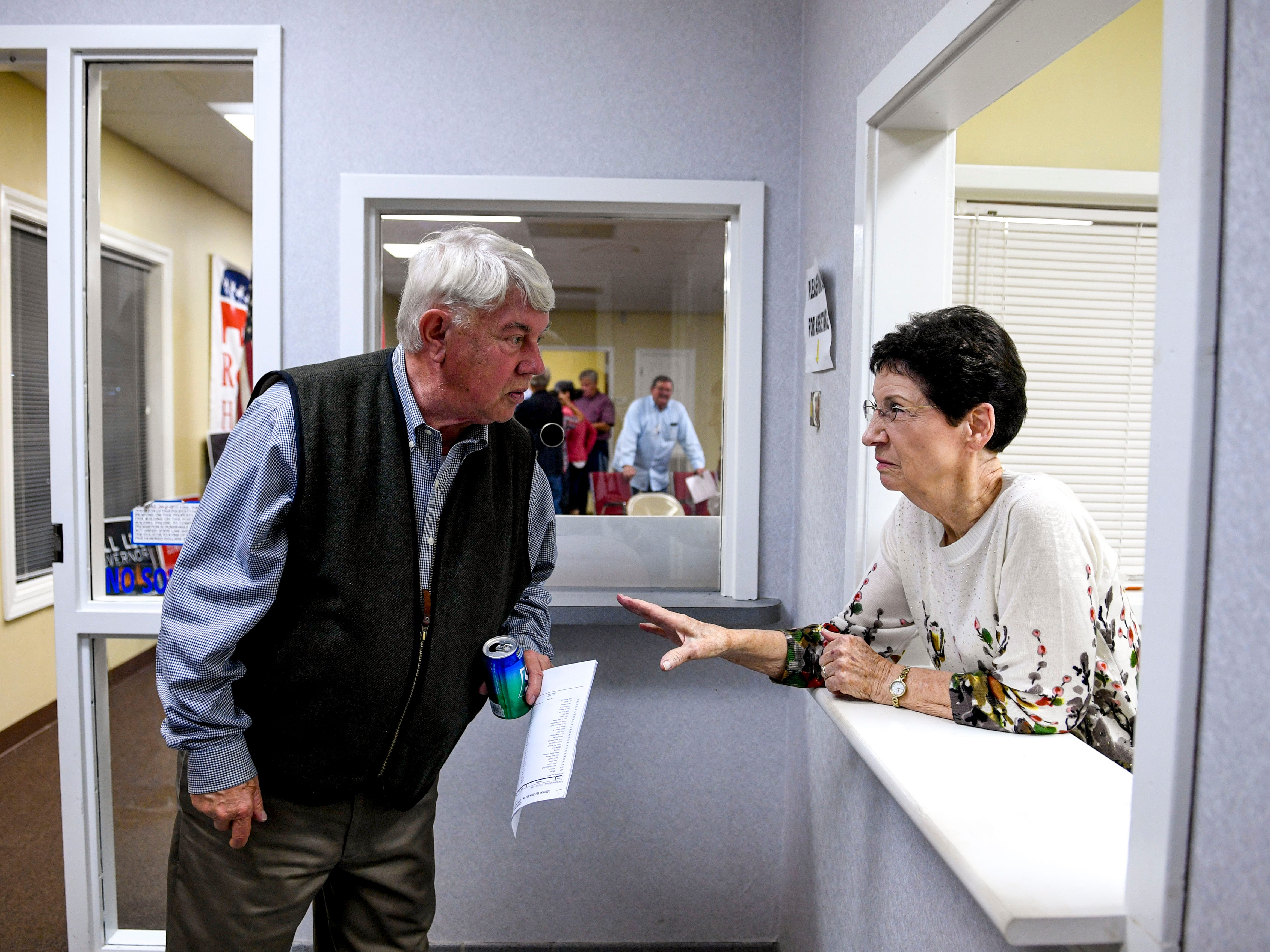 Judy Beeson, right, and Jimmy Eldridge, left, speak with one another during an election night watch party at Madison County Republican Headquarters in Jackson, Tenn., on Tuesday, Nov. 6, 2018.