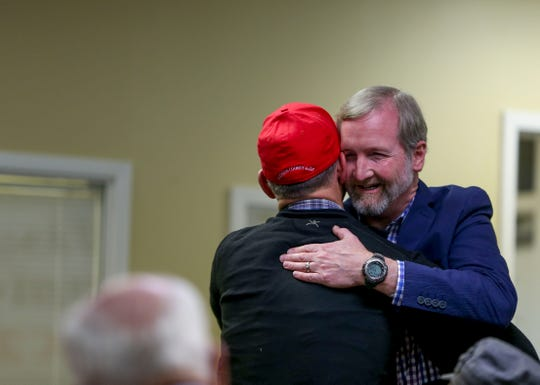 State representative for the 73rd district Chris Todd embraces Glen Gaugh after winning his race and arriving at an election night watch party at Madison County Republican Headquarters in Jackson, Tenn., on Tuesday, Nov. 6, 2018.