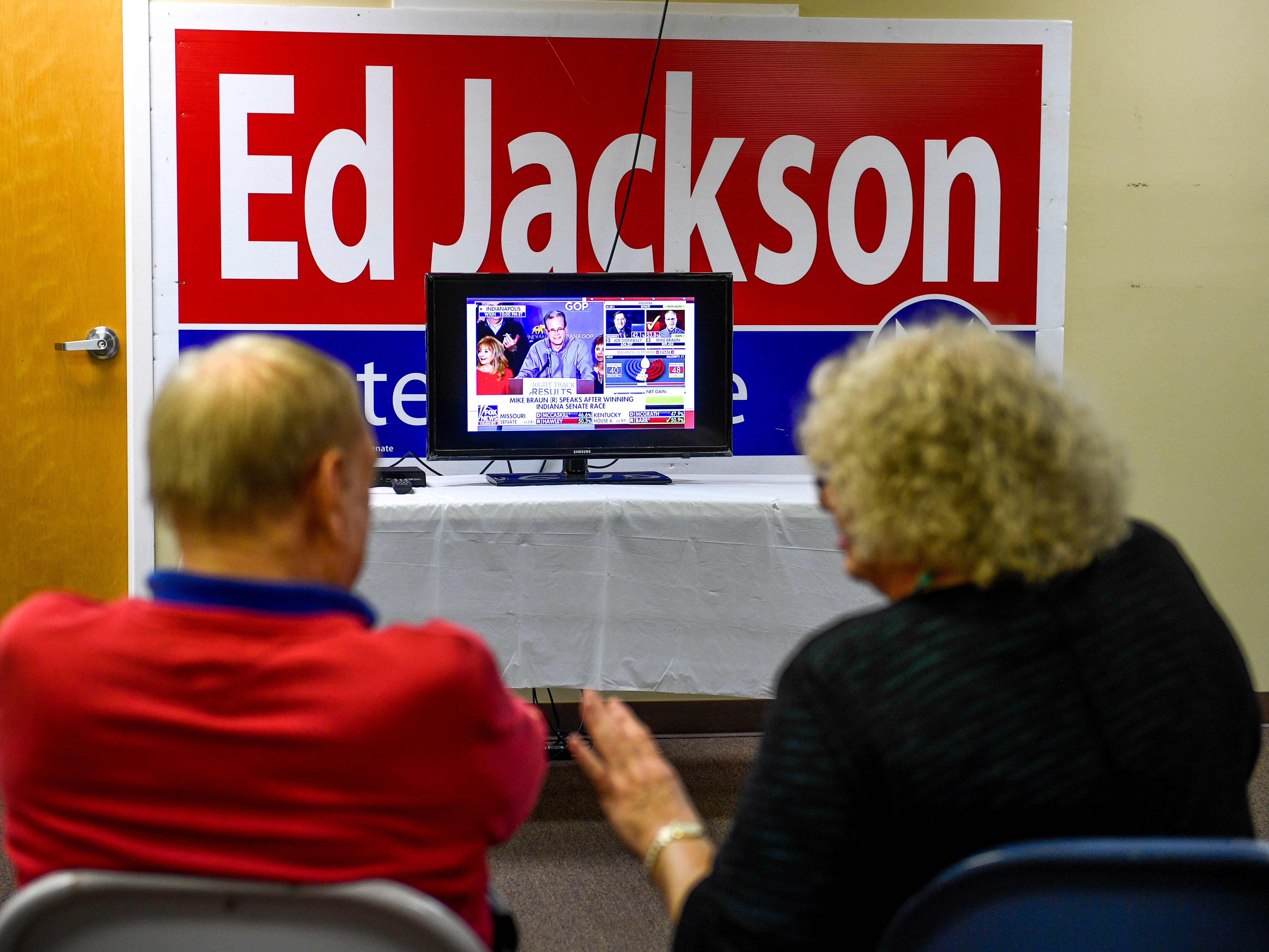 Tom Beeson, left, speaks with Lynn Sorrell, mother in law of Chris Todd, during an election night watch party at Madison County Republican Headquarters in Jackson, Tenn., on Tuesday, Nov. 6, 2018.