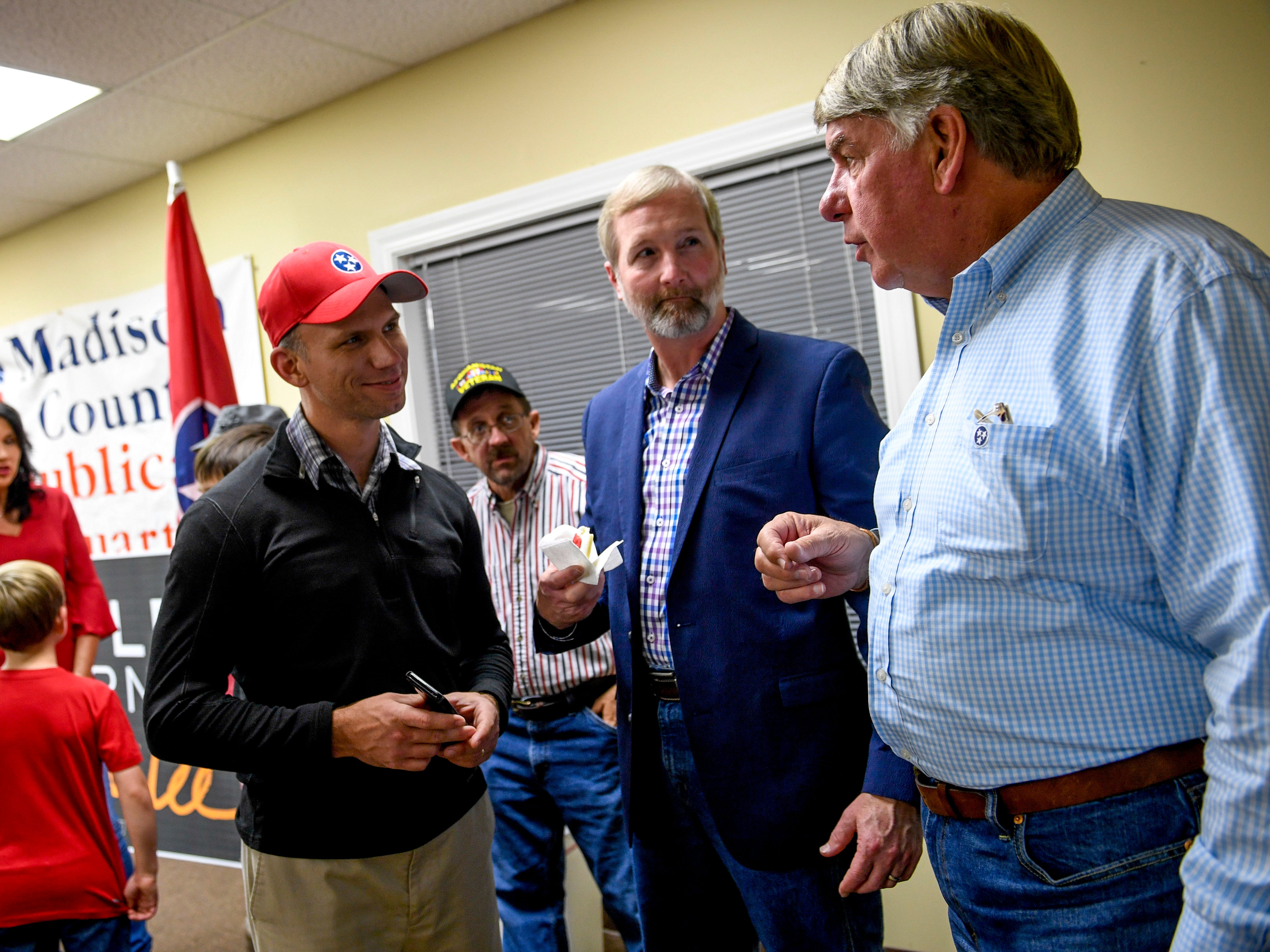 State Senator for District 27 Ed Jackson, right, speaks with Chris Todd, center, and Glen Gaugh, left, during an election night watch party at Madison County Republican Headquarters in Jackson, Tenn., on Tuesday, Nov. 6, 2018.