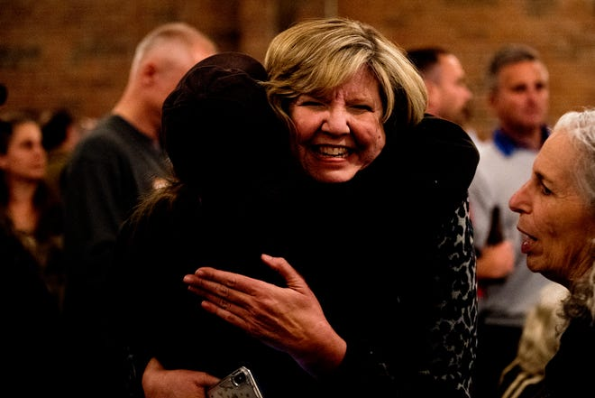 Gloria Johnson gives a supporter a hug an election night watch party at The Standard in Knoxville on Nov. 6.
