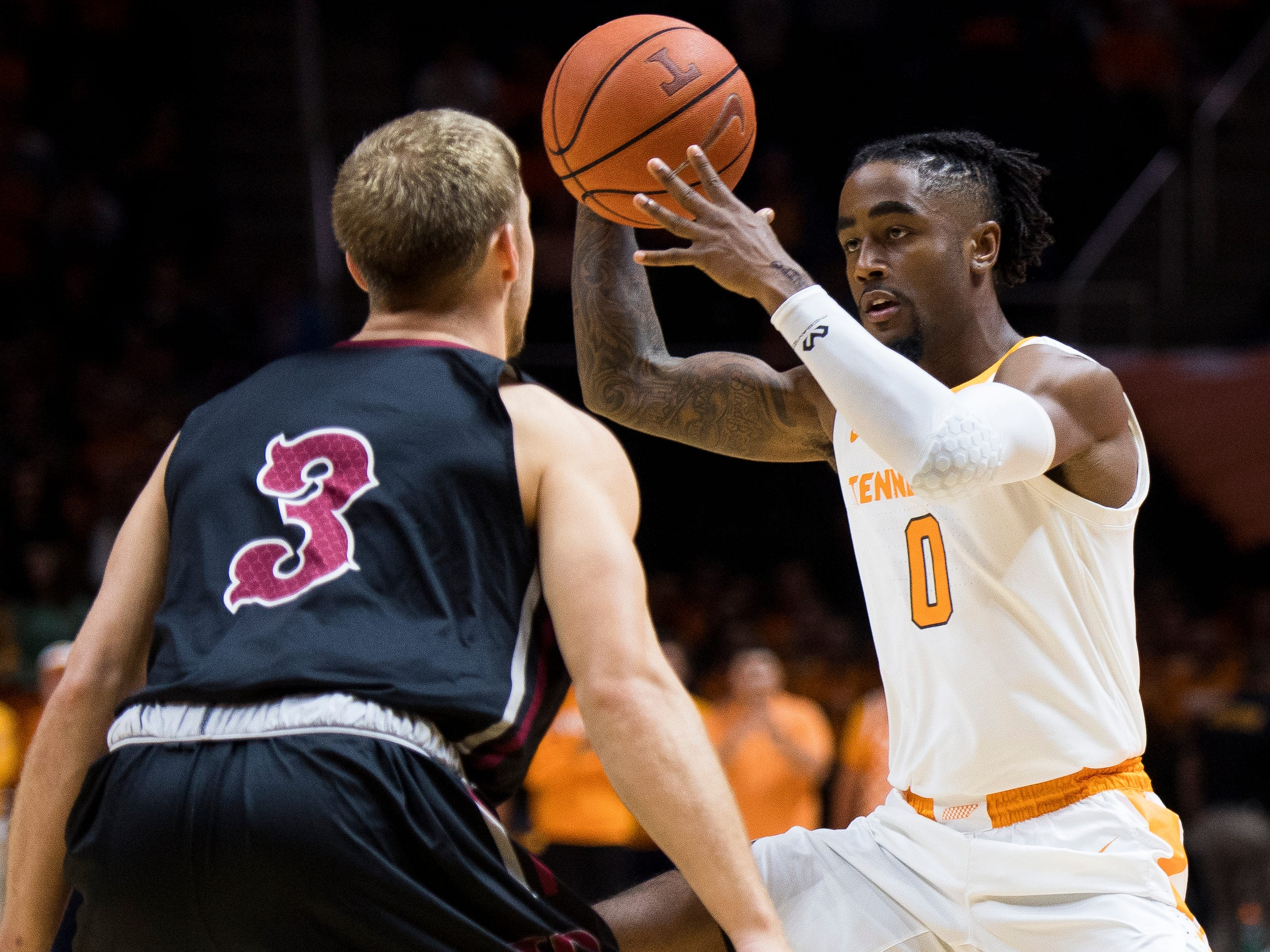 Tennessee guard Jordan Bone (0) moves past Lenoir-Rhyne guard Mason Hawks (3) during Tennessee's basketball game against Lenoir-Rhyne at Thompson-Boling Arena in Knoxville on Tuesday, November 6, 2018.