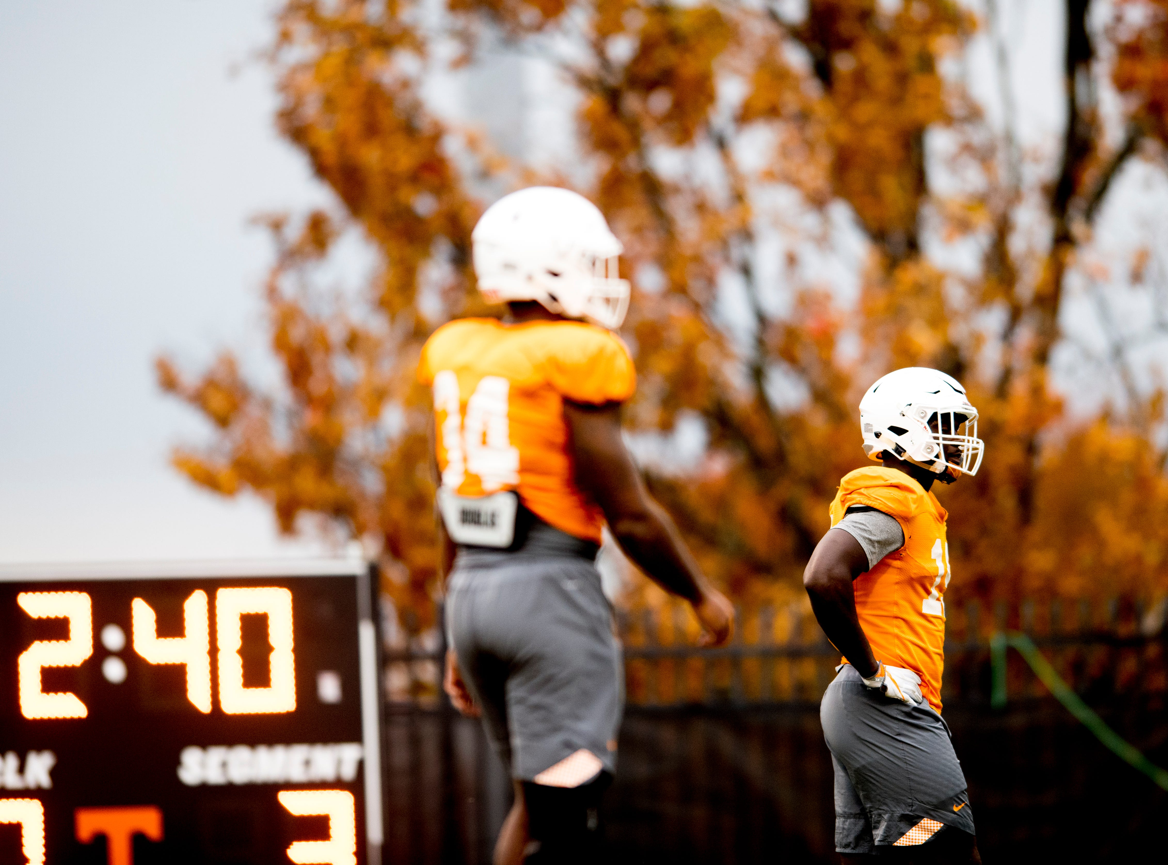 Tennessee linebacker Darrell Taylor (19) and Tennessee linebacker Darrin Kirkland Jr. (34) walk on the field during Tennessee fall football practice at Haslam Field in Knoxville, Tennessee on Wednesday, November 7, 2018.