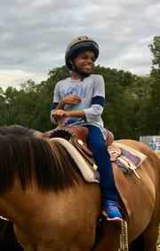 Neveah flashes a big smile during a recent ride.