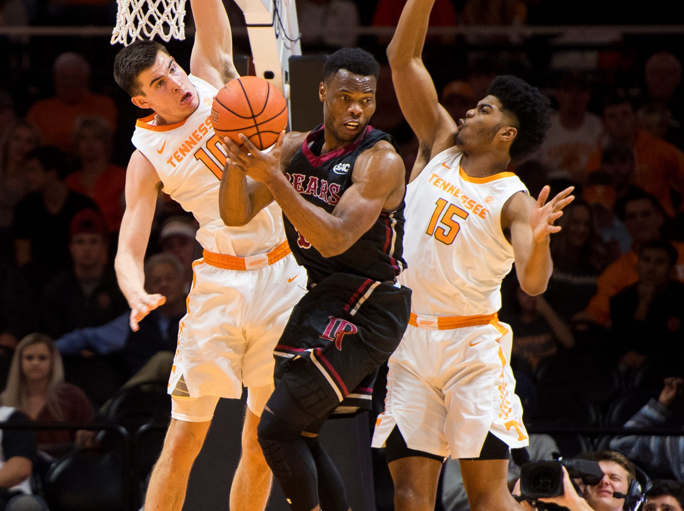 Tennessee forward John Fulkerson (10) and Tennessee forward Derrick Walker (15) defends Lenoir-Rhyne guard Djibril Diallo (13) during Tennessee's basketball game against Lenoir-Rhyne at Thompson-Boling Arena in Knoxville on Tuesday, November 6, 2018.