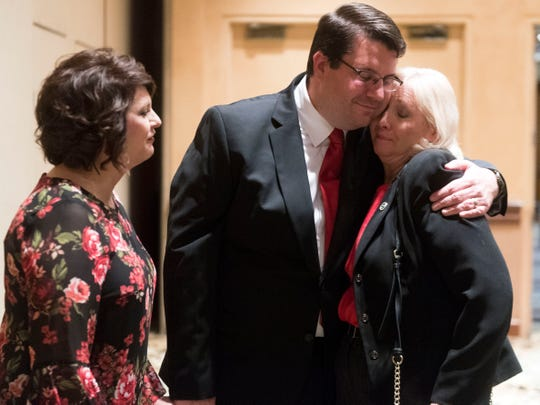 Republican Eddie Smith is hugged by Becky Duncan Massey, R-Knoxville as Smith arrives for the Knox County GOP election party to give his concession speech with wife Lanna Keck on Tuesday, November 6, 2018 at the Crown Plaza Hotel.