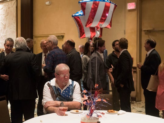 Guests mingle at the Knox County GOP election party at the Crown Plaza Hotel on Tuesday.