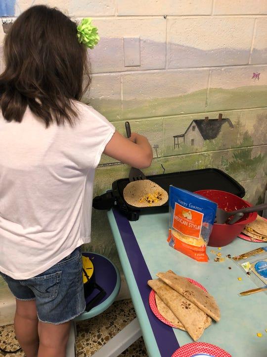 One of Jordan Frye's most popular programs has been Adventures in Cooking for kids.