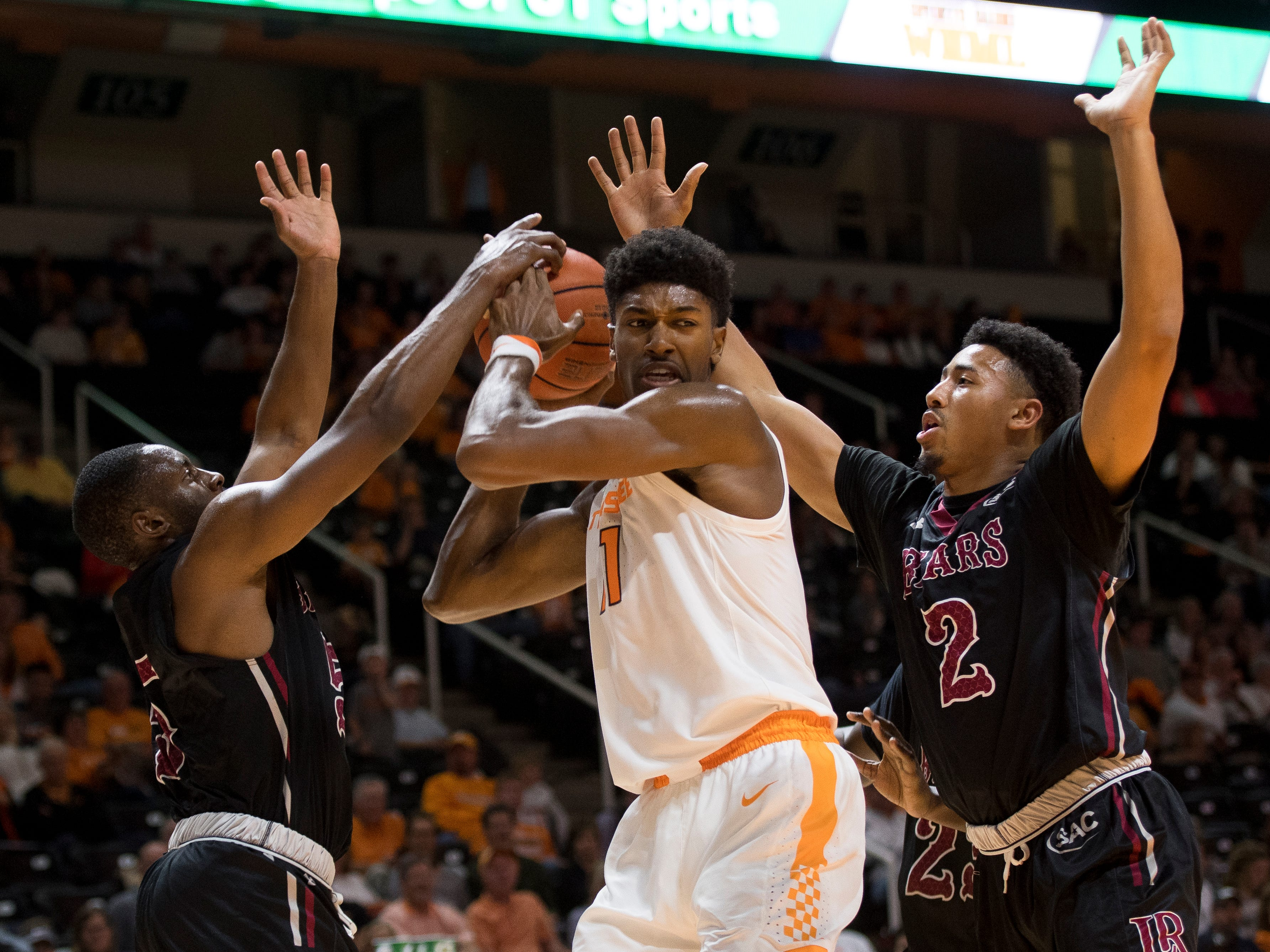 Tennessee forward Kyle Alexander (11) fights off Lenoir-Rhyne guard Khaileel Dailey (2) and Lenoir-Rhyne guard Jalen Johnson (5) during Tennessee's basketball game against Lenoir-Rhyne at Thompson-Boling Arena in Knoxville on Tuesday, November 6, 2018.
