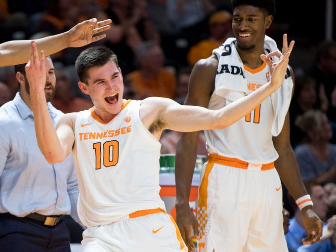 Tennessee forward John Fulkerson (10) celebrates on the bench as Tennessee forward Kyle Alexander (11) watches in amusement during Tennessee's basketball game against Lenoir-Rhyne at Thompson-Boling Arena in Knoxville on Tuesday, November 6, 2018.
