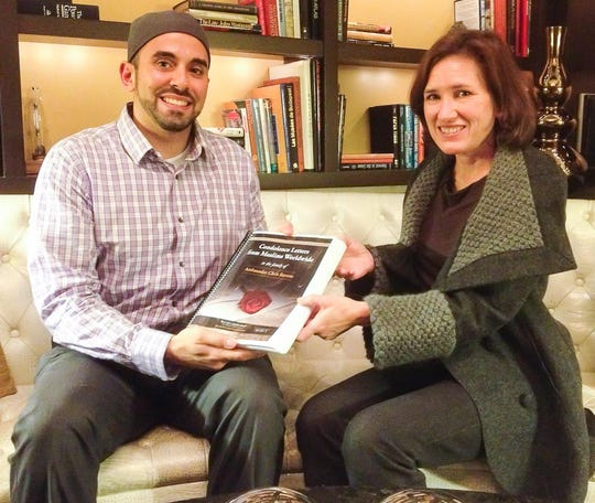Knoxville native Tarek El-Messidi, left, presents a book of 7,500 condolence letters written from Muslims and other individuals in 115 countries to Dr. Anne Stevens, the sister of U.S. Ambassador to Libya Chris Stevens, in Washington, D.C.  Stevens was killed Sept. 11, 2012, in what is widely considered a terrorist attack by Islamic militants. El-Messidi, an American Muslim, organized the letter-writing campaign to foster understanding and peace.