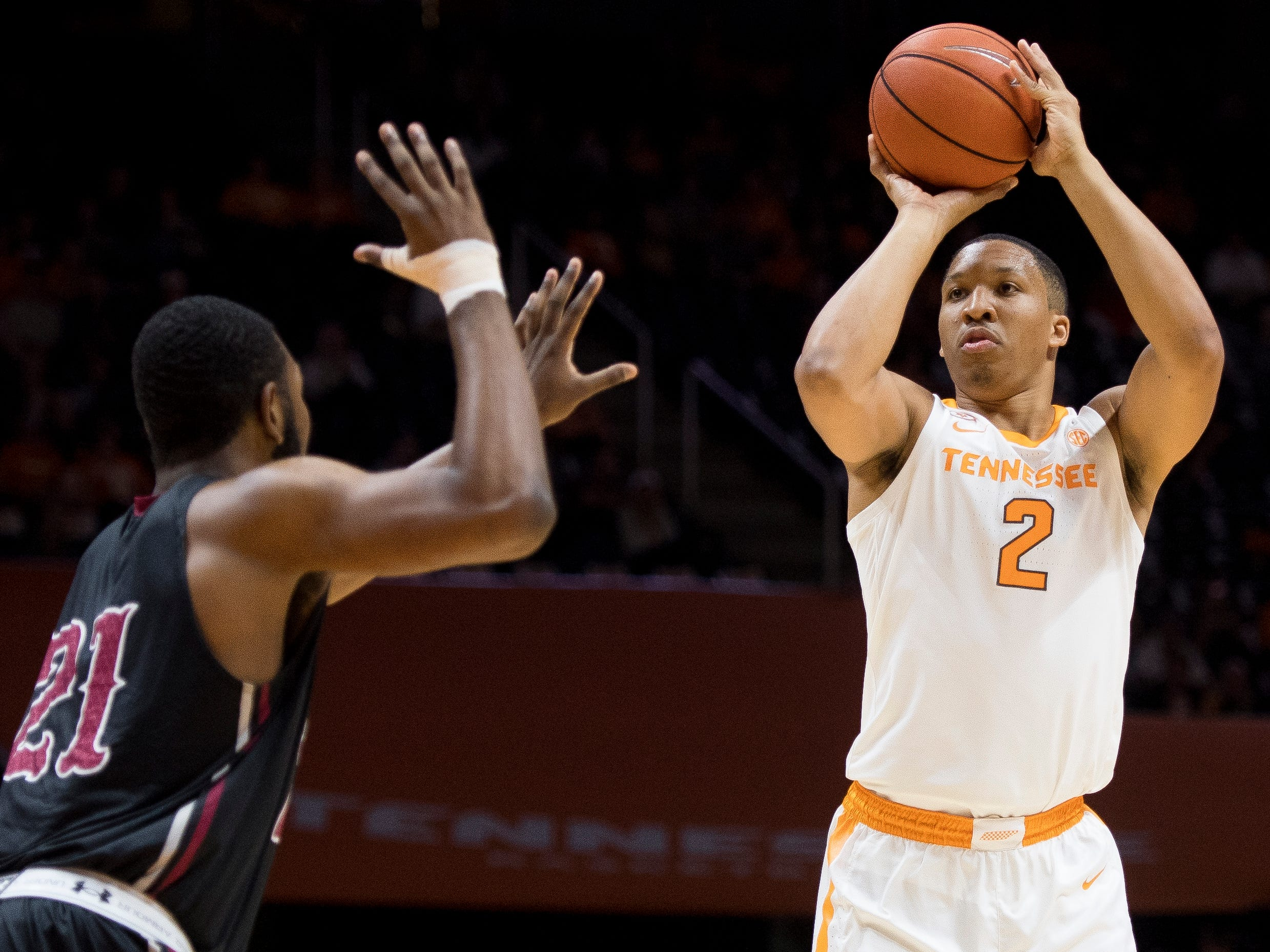 Tennessee forward Grant Williams (2) attempts a shot past Lenoir-Rhyne guard R.J. Gunn (21) during Tennessee's basketball game against Lenoir-Rhyne at Thompson-Boling Arena in Knoxville on Tuesday, November 6, 2018.