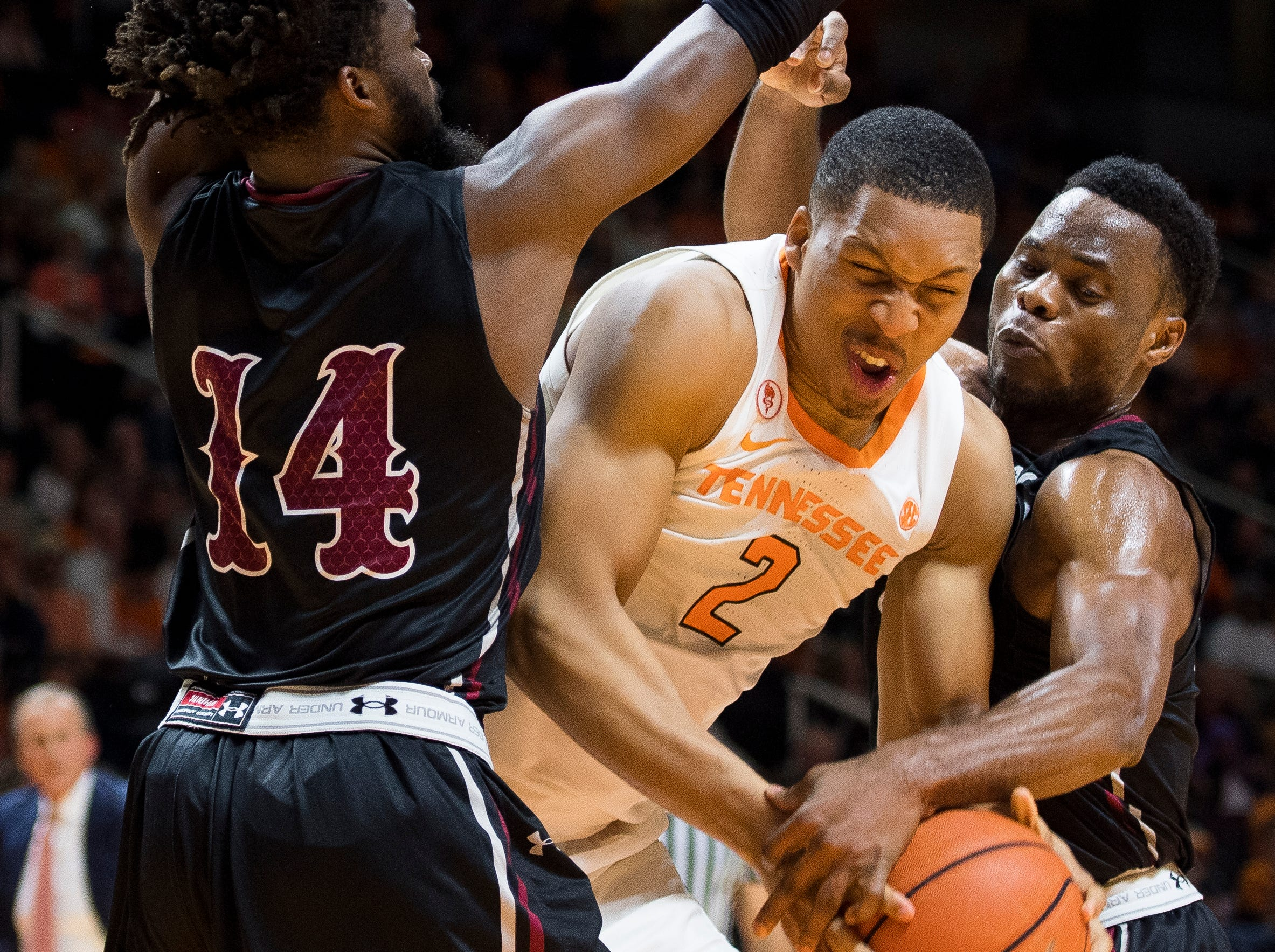Tennessee forward Grant Williams (2) squeezes in between Lenoir-Rhyne guard Cory Thomas (14) and Lenoir-Rhyne guard Djibril Diallo (13) during Tennessee's basketball game against Lenoir-Rhyne at Thompson-Boling Arena in Knoxville on Tuesday, November 6, 2018.
