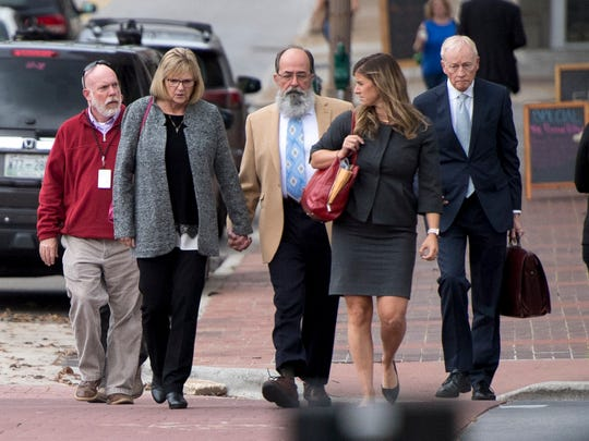 Former Pilot Flying J employee Vicki Borden, second from left, walks into U.S. District Court in Chattanooga on Wednesday, November 7, 2018.