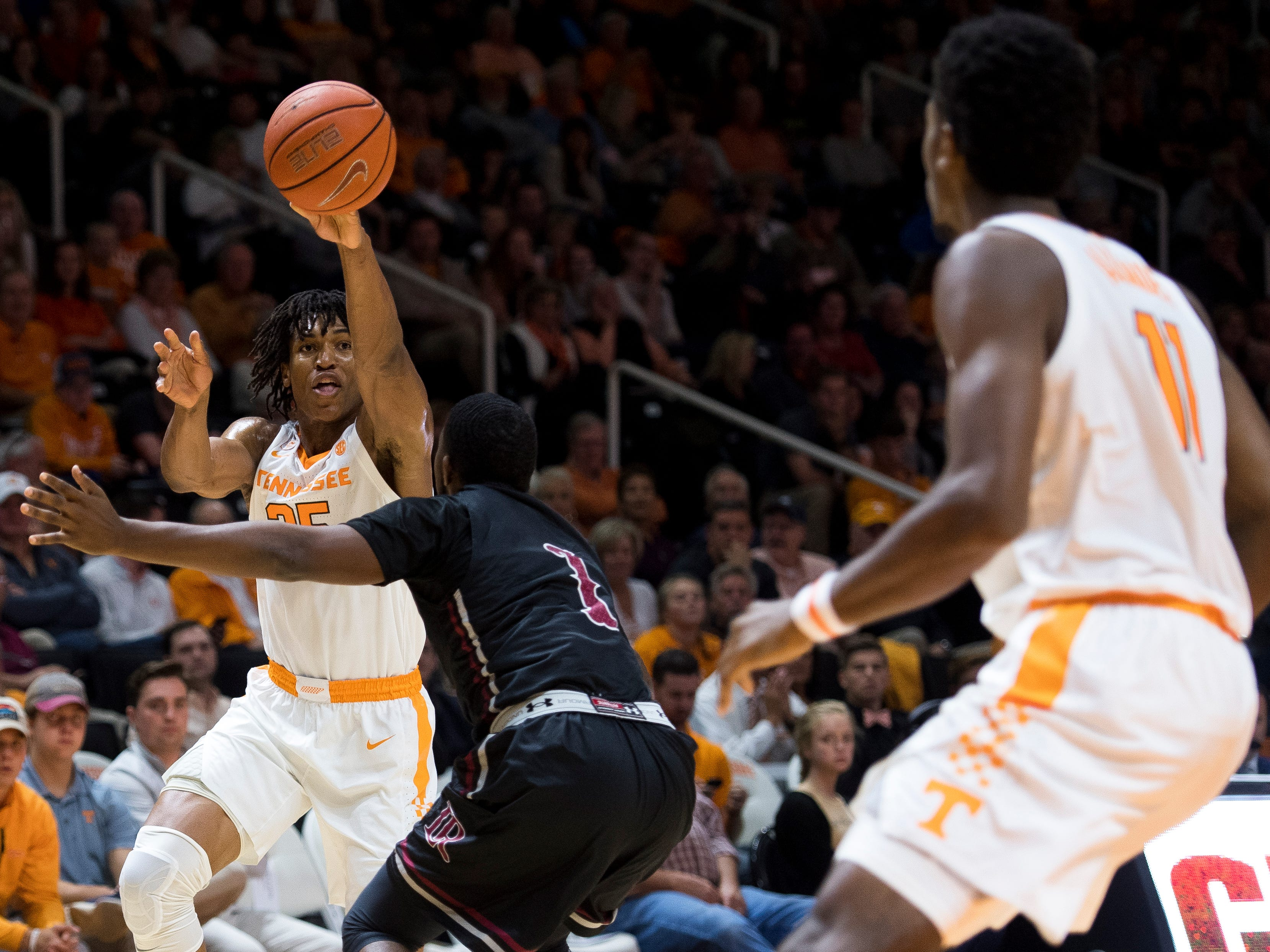 Tennessee guard/forward Yves Pons (35) passes the ball to Tennessee forward Kyle Alexander (11) during Tennessee's basketball game against Lenoir-Rhyne at Thompson-Boling Arena in Knoxville on Tuesday, November 6, 2018.