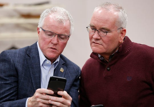 Roland Winger, left, and Tom Murtaugh check election returns Tuesday, November 6, 2018, at the County Office Building. Winger, a Republican, defeated Democrat Erica Beumel in the County Council District 2 race.