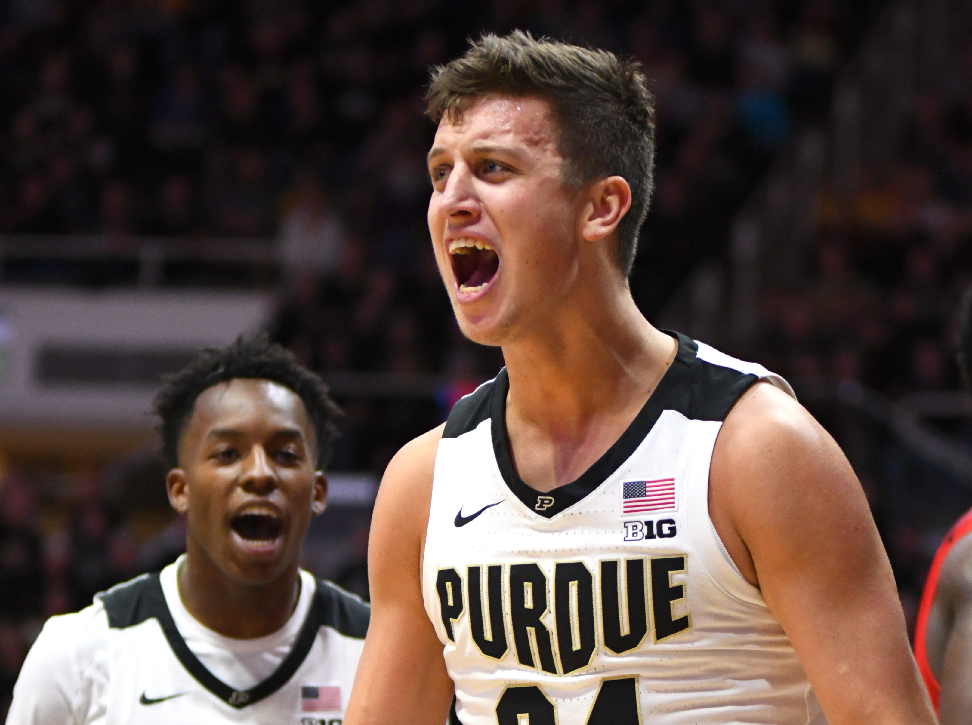 Purdue's Grady Eifert celebrates a hard fought two points as Eric hunter Jr., left, joins in against Fairfield in West Lafayette on Tuesday November 11, 2018.