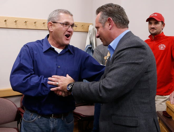 Tippecanoe County Sheriff's candidates Bob Goldsmith, left, and Jason Dombkowski shake hands Tuesday, November 6, 2018, at the County Office Building. Goldsmith, a Democratl narrowly defeated Dombkowski.