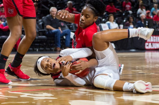 UL freshman Brandi Williams hustles for possession of the ball during the Cajuns' 79-77 overtime loss to Lamar on Tuesday at the Cajundome.