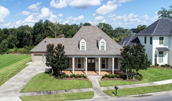 This 4 bedroom, 3 1/2 bath home is located at 304 Brightwood Drive in Lafayette. It is listed at $929,000.