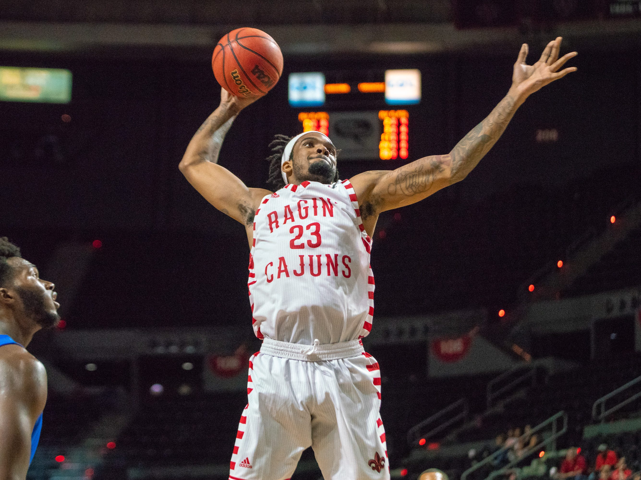 UL's Jakeenan Gant scores with a powerful dunk as the Ragin' Cajuns take on the University of the Virgin Islands Buccaneers at the Cajundome on Nov. 6, 2018.