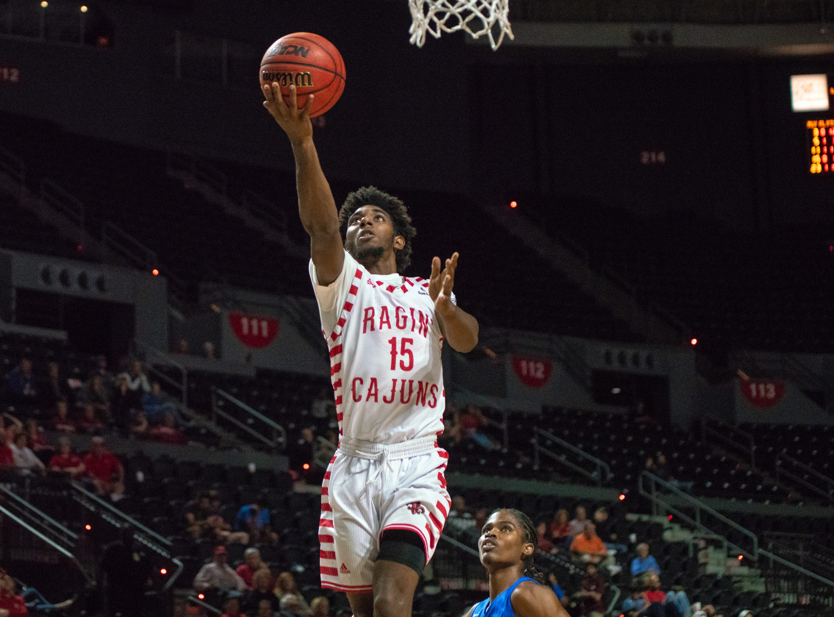 UL's P.J. Hardy goes up for an open layup as the Ragin' Cajuns take on the University of the Virgin Islands Buccaneers at the Cajundome on Nov. 6, 2018.