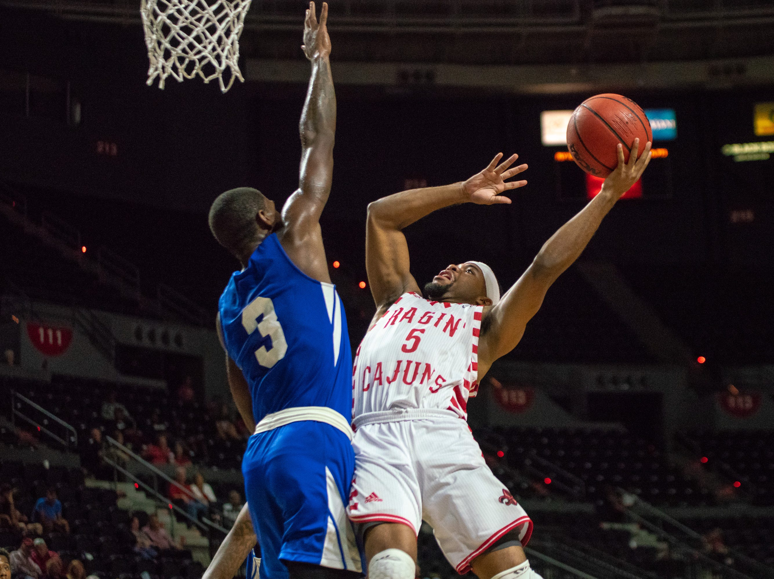 UL's Trajan Wesley scores with a layup as the Ragin' Cajuns take on the University of the Virgin Islands Buccaneers at the Cajundome on Nov. 6, 2018.