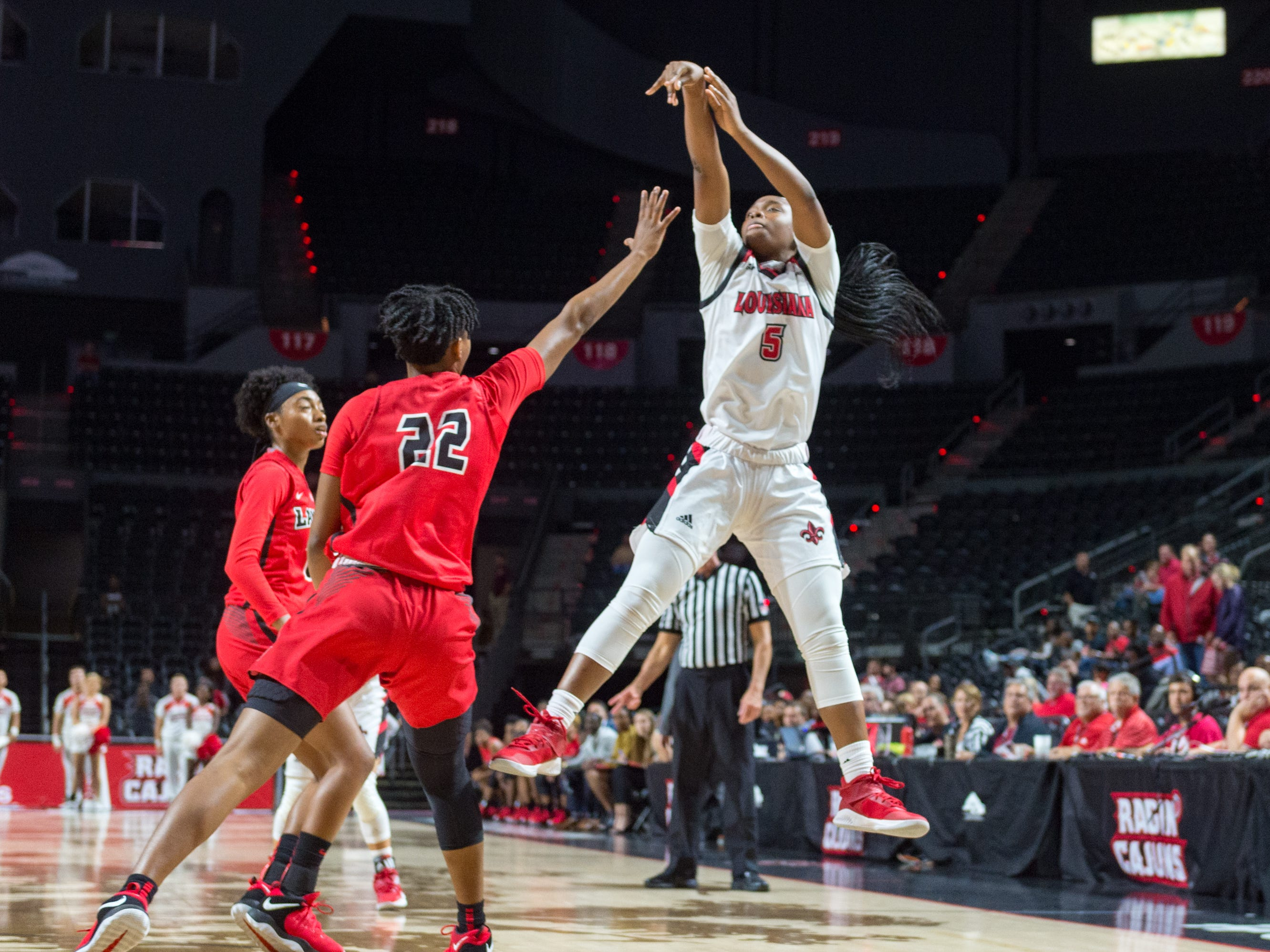Jamyra Mathis shoots a long two point shot as the Cajuns take on Lamar in Womens Basketball. Tuesday, Nov. 6, 2018.