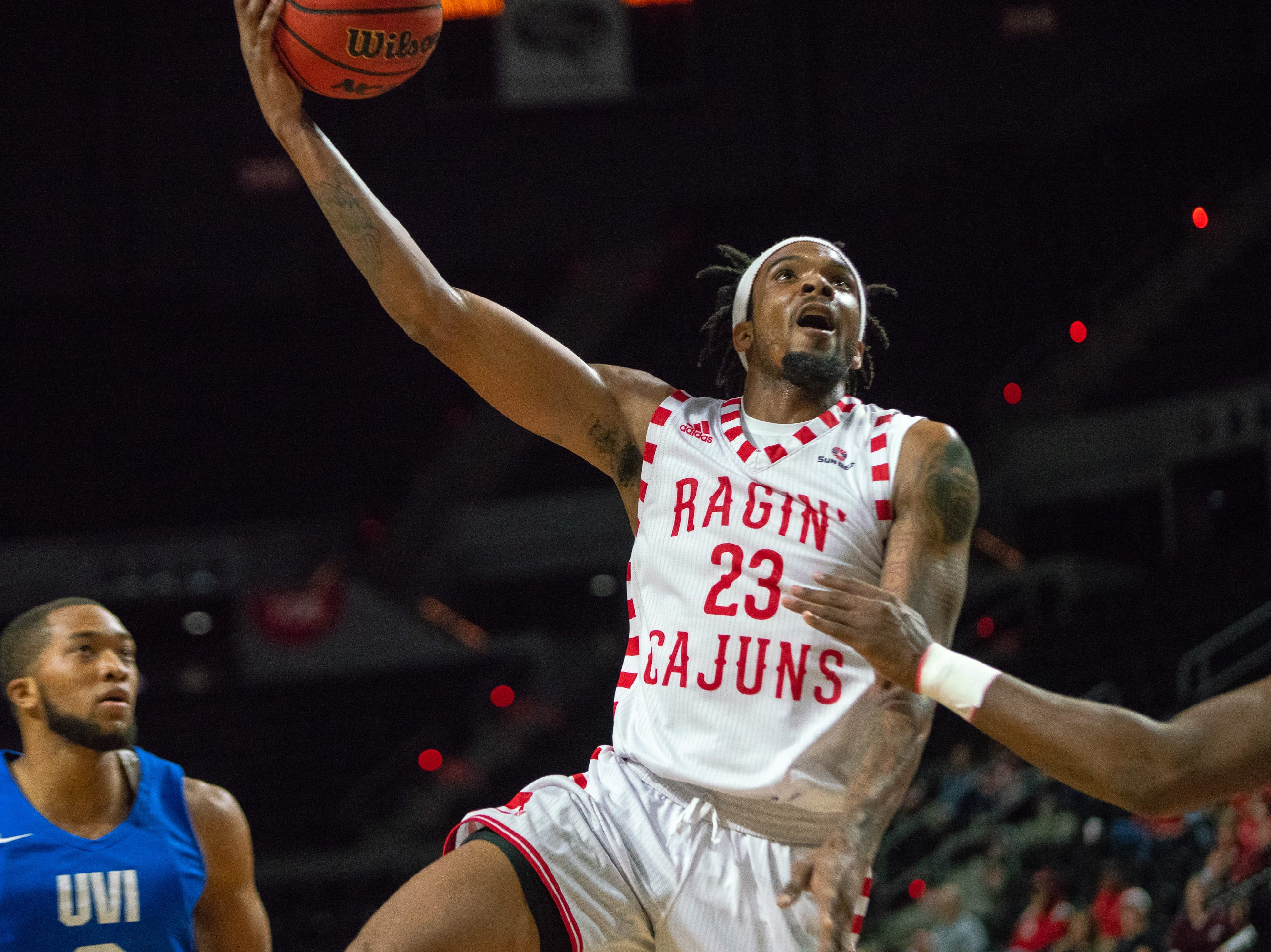 UL's Jakeenan Gant goes up to the goal for a layup as the Ragin' Cajuns take on the University of the Virgin Islands Buccaneers at the Cajundome on Nov. 6, 2018.