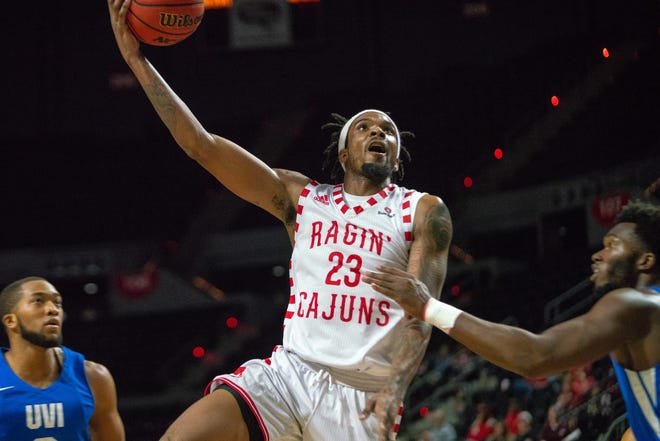 UL's Jakeenan Gant goes up to the goal for a layup as the Ragin' Cajuns take on the University of the Virgin Islands Buccaneers Tuesday. Gant finished with 19 points in the game.