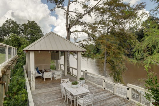 The outdoor spaces all overlook the river.