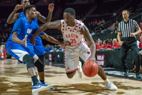 UL's Marcus Stroman charges through the opposing defense as the Ragin' Cajuns take on the University of the Virgin Islands Tuesday. Stroman had eight points, eight rebounds and 10 assists against the Buccaneers.