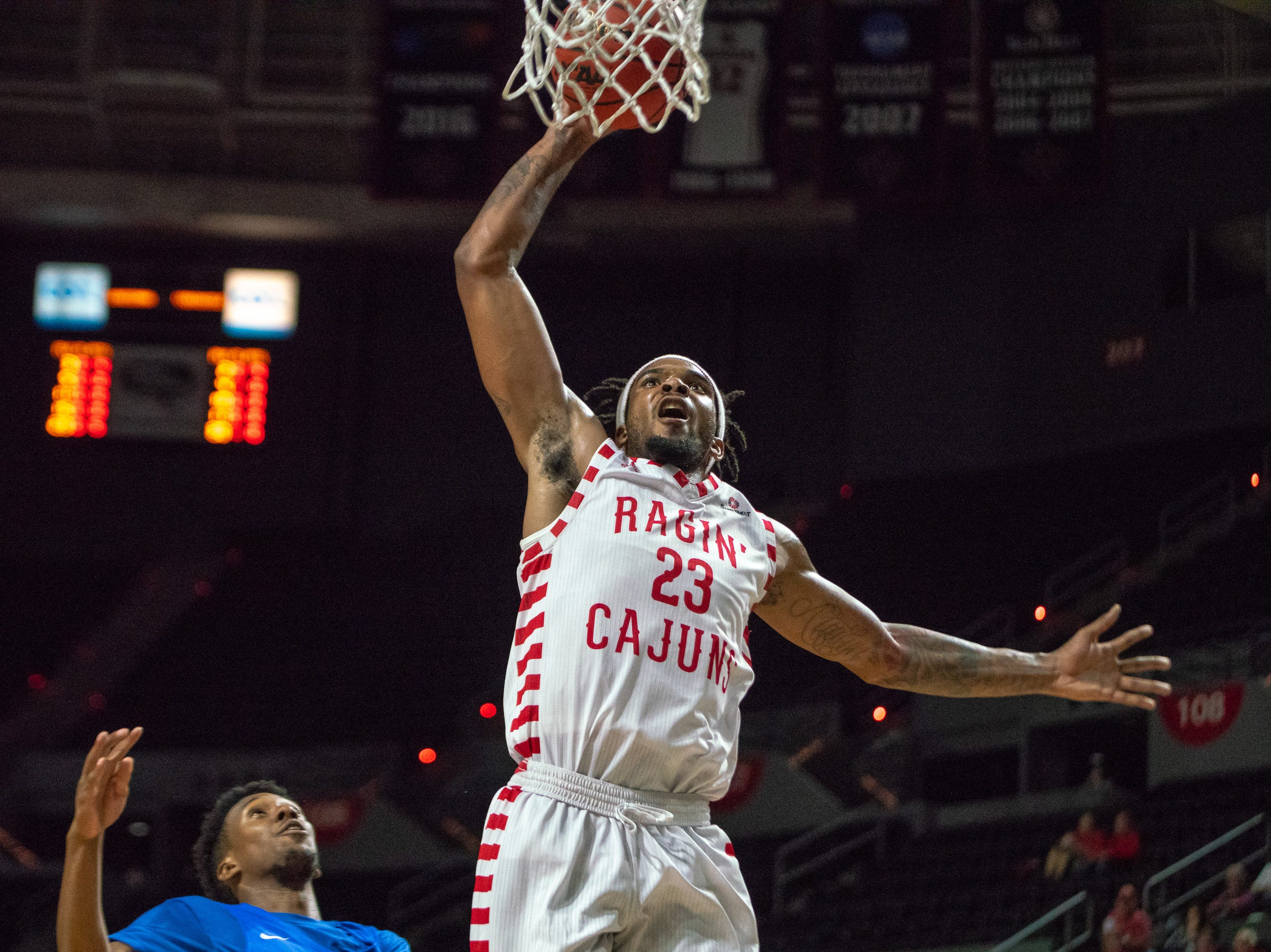 UL's Jakeenan Gant leaps up for a dunk as the Ragin' Cajuns take on the University of the Virgin Islands Buccaneers at the Cajundome on Nov. 6, 2018.