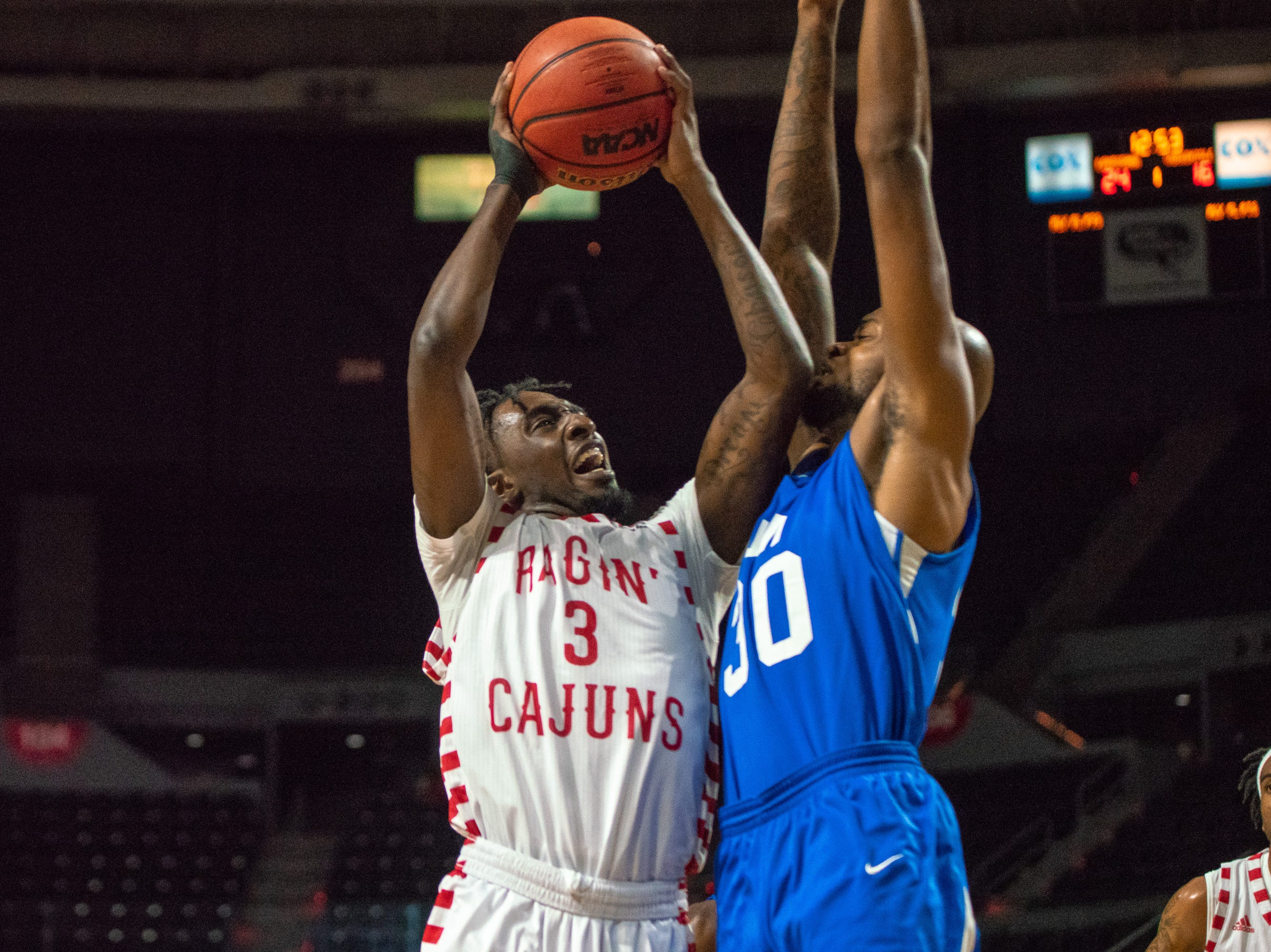 UL's Jeremy Hayes jumps up to the goal to score as the Ragin' Cajuns take on the University of the Virgin Islands Buccaneers at the Cajundome on Nov. 6, 2018.