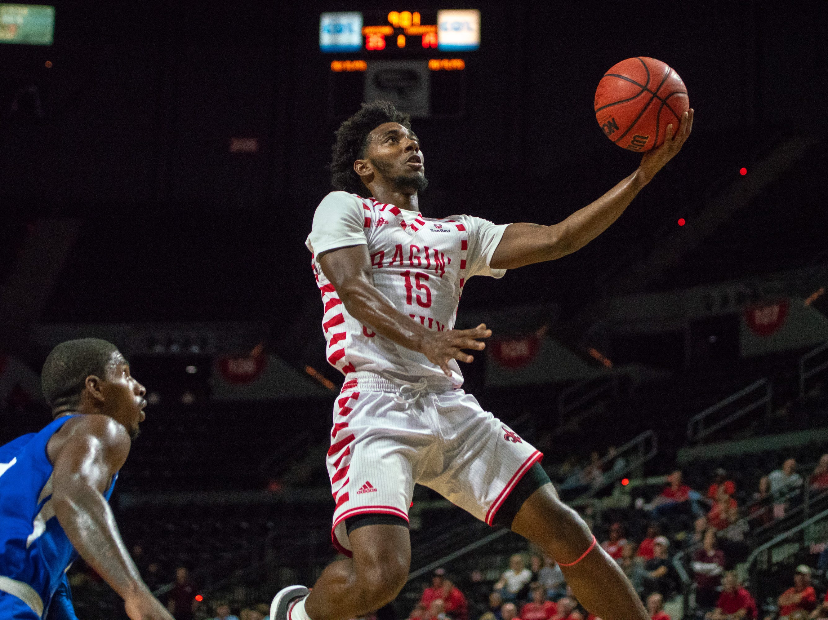 UL's P.J. Hardy goes up to score a layup as the Ragin' Cajuns take on the University of the Virgin Islands Buccaneers at the Cajundome on Nov. 6, 2018.