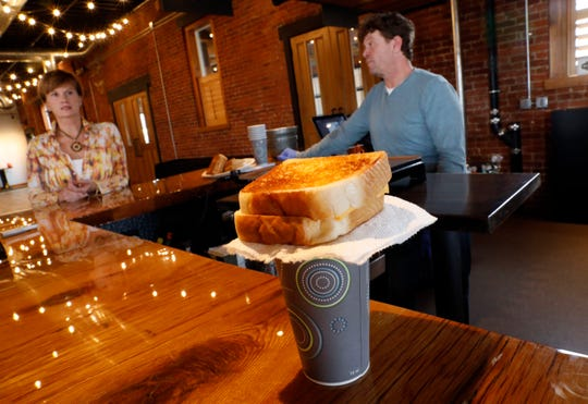 A grilled cheese sandwich sits on top of a cup of tomato soup as Lorena, left, and Billy Smith talk about their disaster relief trailer FreeChee. The Smith plan to take the trailer to disaster sites throughout the country to help feed people.
